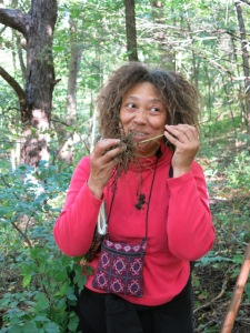 A participant in a wildcrafting workshop explores the Blue Cohosh