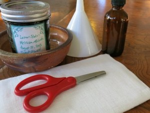 scissors cheesecloth glass bottle funnel infused herbal oil